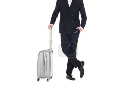 Photo for Cropped view of elegant man in black tuxedo posing with travel bag isolated on white - Royalty Free Image