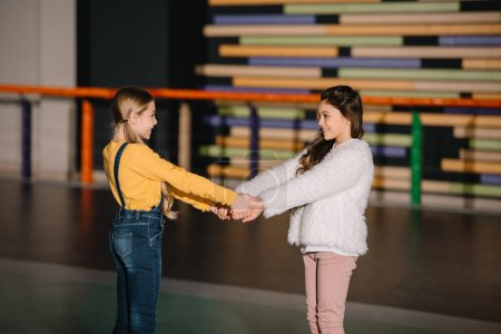 Photo for Two beautiful children smiling and holding hands - Royalty Free Image