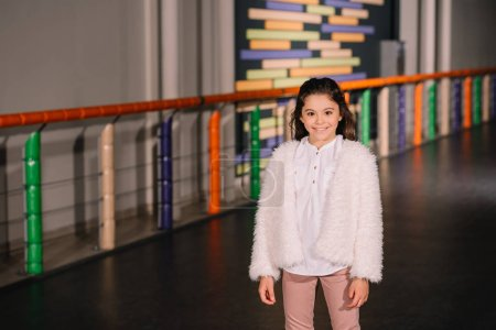 Photo for Cheerul brunette kid posing with smile on skating rink - Royalty Free Image