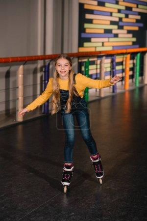 Photo for Female roller skater in jeans enjoying childhood - Royalty Free Image