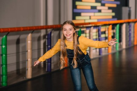 Photo for Active kid with long hair posing on roller rink - Royalty Free Image