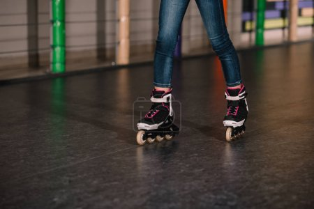 Photo for Cropped view of child practicing on roller rink - Royalty Free Image