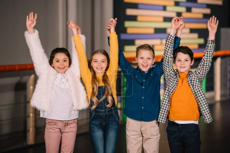 Photo for Group of kids laughing and holding hands - Royalty Free Image