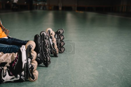 Photo for Cropped view of kids wears roller skates - Royalty Free Image