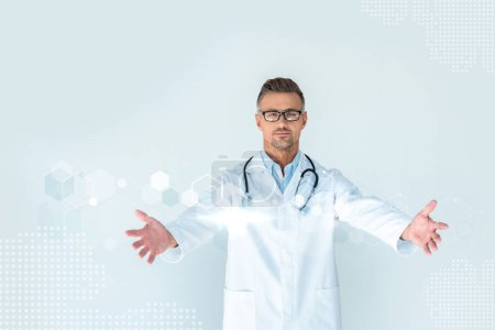 Photo for Handsome doctor in glasses with stethoscope on shoulders standing with open arms with innovation technology interface - Royalty Free Image