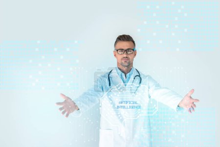 Photo for Handsome doctor in glasses with stethoscope on shoulders standing with open arms with brain interface and artificial intelligence lettering - Royalty Free Image