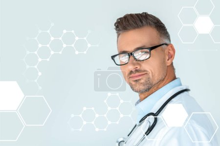 Photo for Portrait of handsome doctor in glasses with stethoscope on shoulders looking at camera isolated on white with medical symbols - Royalty Free Image