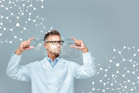 Photo for Handsome scientist in glasses holding dna interface isolated on grey, artificial intelligence concept - Royalty Free Image
