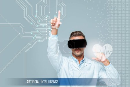 Photo for Scientist in virtual reality headset touching medical care interface with heartbeat isolated on grey, artificial intelligence concept - Royalty Free Image