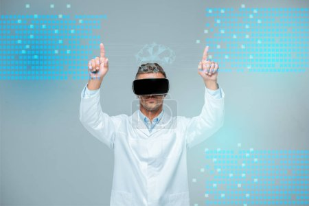 Photo for Scientist in virtual reality headset touching medical interface with brain isolated on grey, artificial intelligence concept - Royalty Free Image