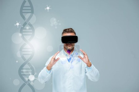 Photo for Scientist in virtual reality headset holding something isolated on grey with dna, artificial intelligence concept - Royalty Free Image