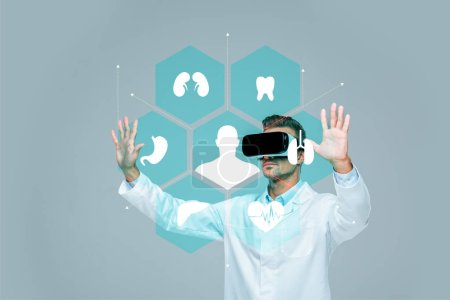 Photo for Scientist in virtual reality headset touching medical interface in air isolated on grey, artificial intelligence concept - Royalty Free Image