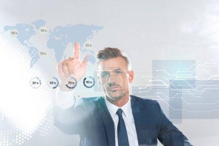 Photo pour Bel homme d'affaires touchant des icônes d'affaires avec doigt isolé sur le concept d'intelligence artificielle blanc, - image libre de droit