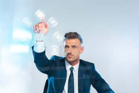Photo for Handsome businessman pointing on icons isolated on white, artificial intelligence concept - Royalty Free Image