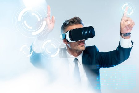 Photo for Businessman in virtual reality headset touching  innovation technology isolated on white, artificial intelligence concept - Royalty Free Image