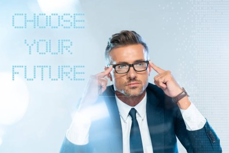 """Photo for Handsome businessman in glasses touching head isolated on white with """"choose your future"""" lettering, artificial intelligence concept - Royalty Free Image"""