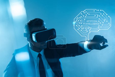 Photo for Businessman in virtual reality headset with brain isolated on blue, artificial intelligence concept - Royalty Free Image