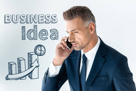 Photo for Portrait of handsome businessman talking by smartphone isolated on white with business idea - Royalty Free Image