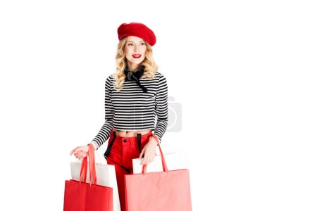 Photo for Smiling woman standing with shopping bags isolated on white - Royalty Free Image