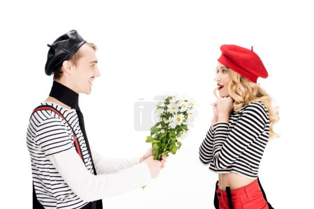Photo for French man giving flowers to attractive woman in red beret isolated on white - Royalty Free Image