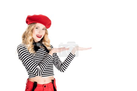 Photo for Attractive woman in red beret showing something isolated on white - Royalty Free Image