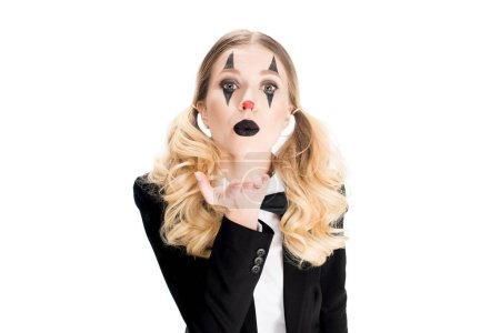 Photo for Blonde female clown standing in suit and sending air kiss isolated on white - Royalty Free Image
