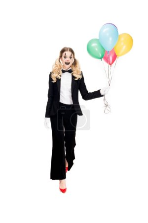 Photo for Happy female clown in suit holding balloons and smiling isolated on white - Royalty Free Image