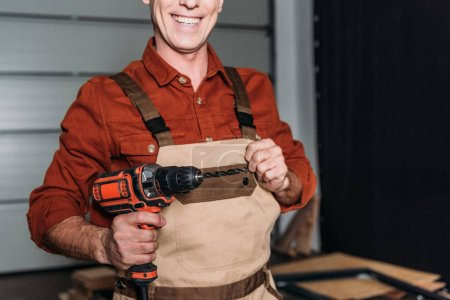 Photo for Cropped view of repairman holding screwdriver in garage - Royalty Free Image