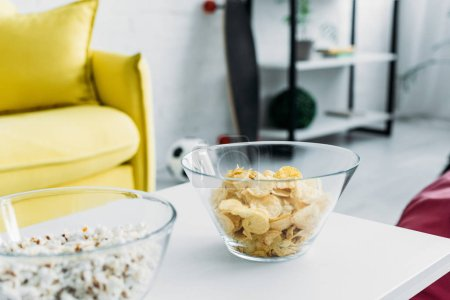 Photo for Selective focus of bowls with cheaps and popcorn - Royalty Free Image