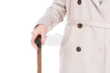 Photo pour Vue recadrée de haute femme tenant canne isolé sur blanc - image libre de droit