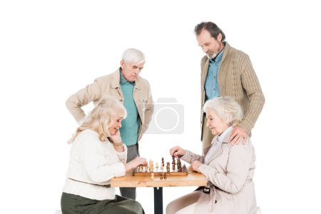 Photo for Retired women playing chess near senior men isolated on white - Royalty Free Image