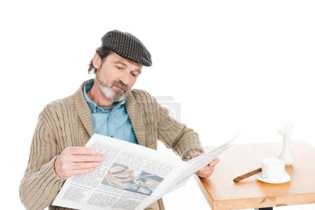 Photo for Senior man reading newspaper isolated on white - Royalty Free Image