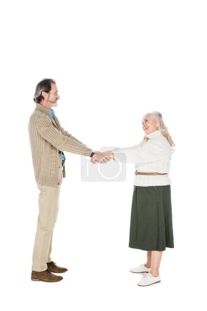 Photo for Cheerful couple shaking hands isolated on white - Royalty Free Image