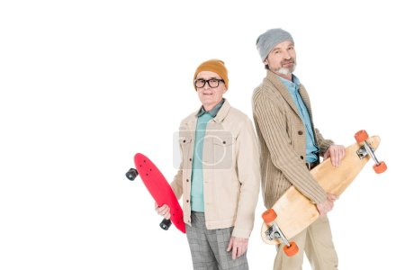 Photo for Stylish senior men holding skateboards isolated on white - Royalty Free Image