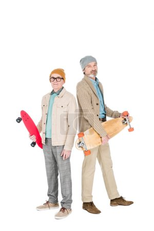 Photo for Stylish retired men holding skateboards isolated on white - Royalty Free Image