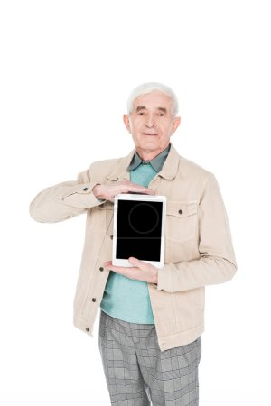 Photo for Retired man holding digital tablet with blank screen isolated on white - Royalty Free Image