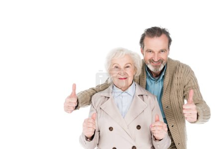 Photo for Cheerful retired couple showing thumbs up isolated on white - Royalty Free Image