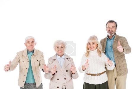 Foto de Personas jubiladas alegres que muestran los pulgares arriba aisladas en blanco - Imagen libre de derechos