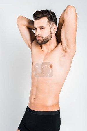 Photo pour Beau jeune barbu homme posant isolés sur gris - image libre de droit