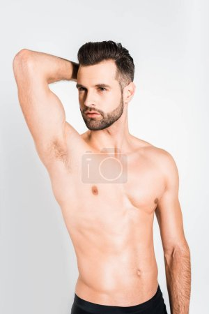Photo for Handsome shirtless young man posing isolated on grey - Royalty Free Image