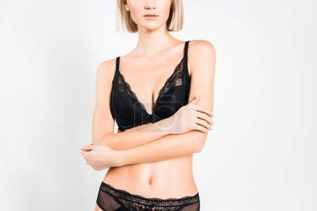 Photo pour Vue recadrée de tendre fille posant en lingerie noire isolée sur gris - image libre de droit