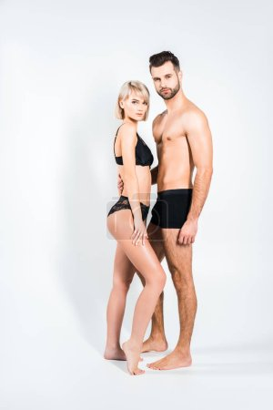 Photo for Beautiful blonde girlfriend and bearded boyfriend in underwear posing on grey - Royalty Free Image