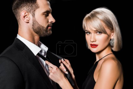 Photo for Beautiful glamour couple posing isolated on black - Royalty Free Image