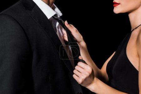 Photo for Cropped view of glamour couple posing isolated on black - Royalty Free Image