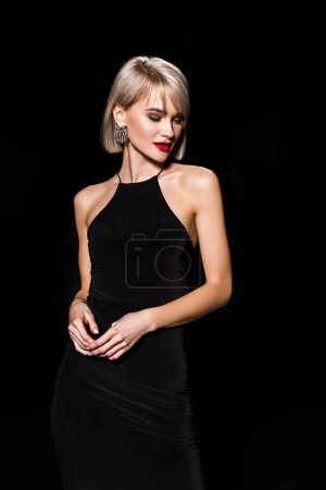 Photo for Elegant young woman in black dress, isolated on black - Royalty Free Image