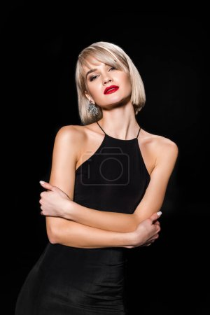 Photo for Attractive glamour woman in black dress posing with crossed arms,, isolated on black - Royalty Free Image