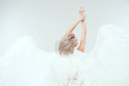 Photo pour Vue arrière de la femme aux ailes d'ange posant isolée sur blanc avec espace de copie - image libre de droit