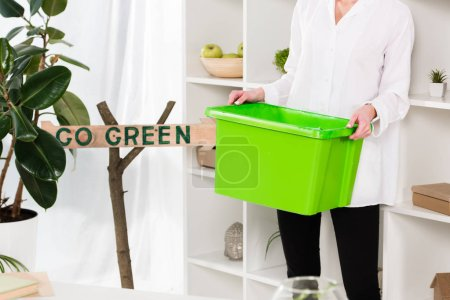 Photo for Cropped view of woman holding green recycling box near go green sign, environmental saving concept - Royalty Free Image