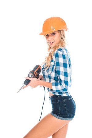 Photo for Attractive handy woman in blue shirt and shorts with screwdriver isolated on white - Royalty Free Image