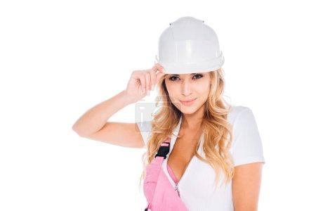 Photo pour Jolie femme pratique en casque blanc, uniforme isolé sur blanc - image libre de droit